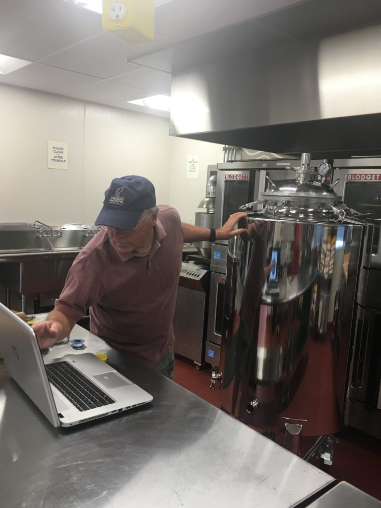 Checking the numbers on the infusion process at the Prep Kitchen
