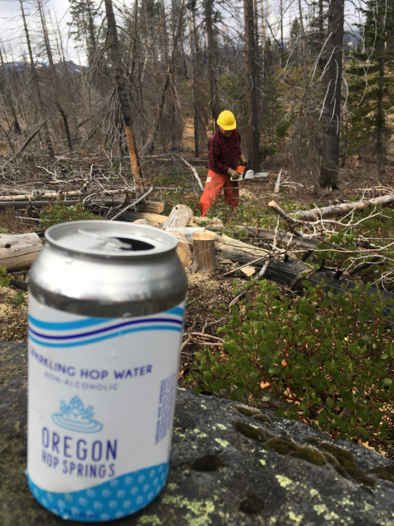 hop-water-while-cutting-firewood